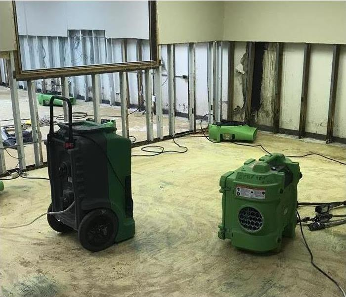 Large office room with dehumidifiers and air movers.