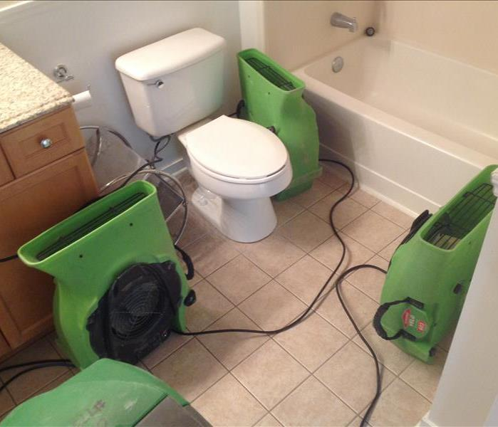 Small bathroom with 3 air movers and a dehumidifier in it