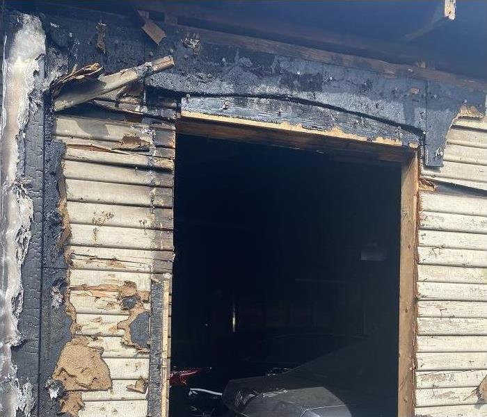 Burned doorway of a garage.