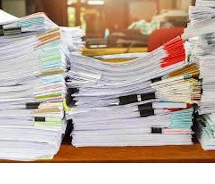 Three piles of documents